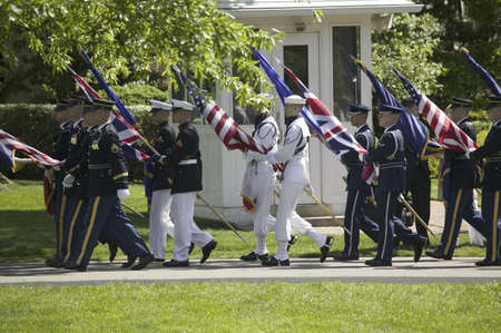 guard house: Military branches carrying the fifty state flags on May 7, 2007 at the White House, as part of the welcoming of Her Majesty Queen Elizabeth II to Washington, DC and America