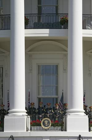 Marine Band Trumpeters standing at ease behind Presidential Seal on the Balcony of the South Portico of the White House on May 7, 2007 as part of the Official State Welcoming of Her Majesty Queen Elizabeth II and Prince Philip, the Duke of Edinburgh to Wa Editorial