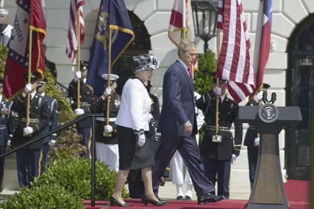 queen elizabeth: President George W. Bush and Queen Elizabeth II walking onto the stage on the South Lawn of the White House for the May 7, 2007 Official State Welcoming of Her Majesty Queen Elizabeth II and Prince Philip, the Duke of Edinburgh to Washington, DC and Ameri