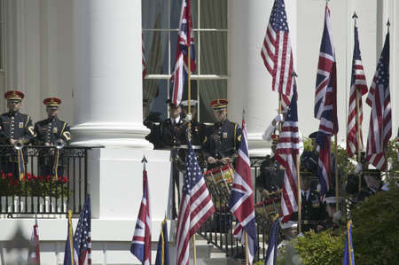 Display of British Union Jack Flag and American Flags signifying the Special Relationship between the United Kingdom and the United States in front of the South Portico of the White House, as part of the Official Welcoming of Her Majesty Queen Elizabeth I