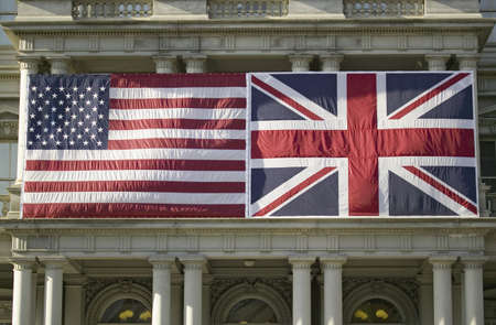 cultural artifacts: American Flag mounted flat next to Union Jack British Flag on the ,Dwight D. Eisenhower Executive Office Building, next to the White House, Washington, DC, symbolizing the Special Relationship between England and America, the two countries that share the