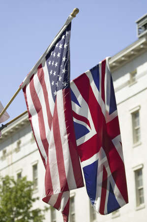 cultural artifacts: American Flag hanging with Union Jack British Flag next to the White House, Washington, DC, symbolizing the Special Relationship between England and America, the two countries that share the oldest international relationship Editorial