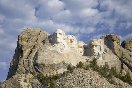 lincoln memorial: White puffy clouds behind Presidents George Washington, Thomas Jefferson, Teddy Roosevelt and Abraham Lincoln at Mount Rushmore National Memorial, South Dakota Editorial