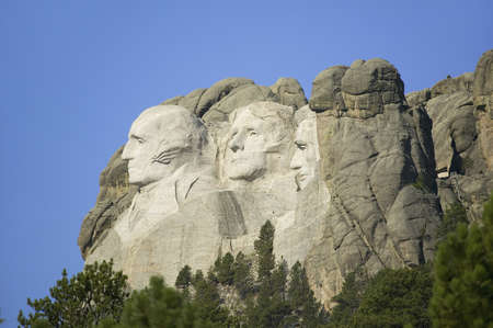 busts: A profile of Presidents George Washington, Thomas Jefferson, Teddy Roosevelt and Abraham Lincoln at Mount Rushmore National Memorial, South Dakota
