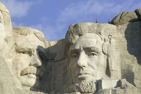 great plains: A park ranger and photographer standing above Abraham Lincoln at Mount Rushmore National Memorial, South Dakota
