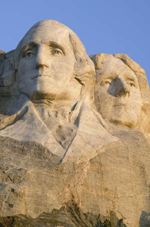 Sunrise on Presidents George Washington, Thomas Jefferson, Teddy Roosevelt and Abraham Lincoln at Mount Rushmore National Memorial, South Dakota