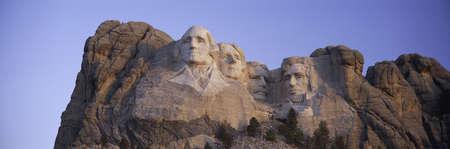 Sunrise panoramic image of Presidents George Washington, Thomas Jefferson, Teddy Roosevelt and Abraham Lincoln at Mount Rushmore National Memorial, South Dakota