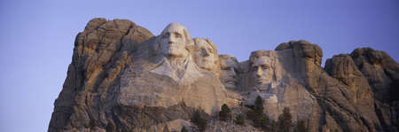 busts: Sunrise panoramic image of Presidents George Washington, Thomas Jefferson, Teddy Roosevelt and Abraham Lincoln at Mount Rushmore National Memorial, South Dakota Editorial