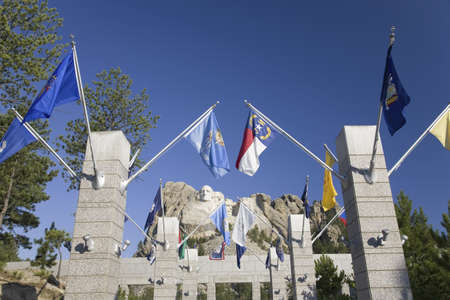 Fifty State flags lining the walkway to Grand Terrace view of Mount Rushmore National Memorial, South Dakota