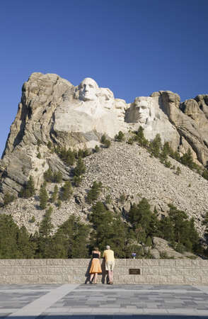 busts: A man and woman at the Grand Terrace view of Mount Rushmore National Memorial, South Dakota