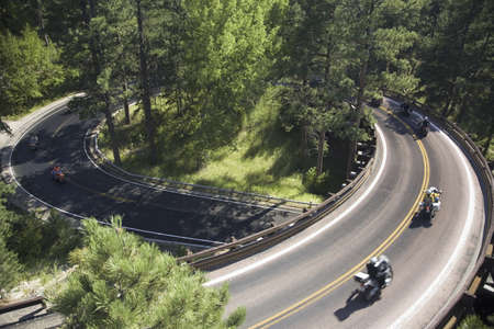 Elevated view of motorcycles driving on Iron Mountain Road, Black Hills, near Mount Rushmore National Memorial, South Dakota Редакционное