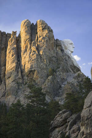 busts: A profile at sunset of George Washington at Mount Rushmore National Memorial, South Dakota Editorial