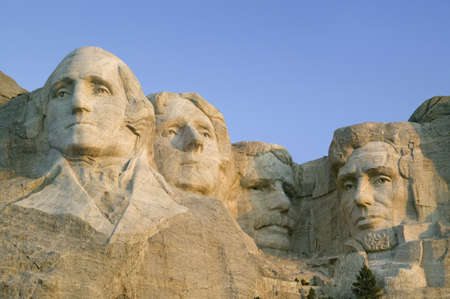 mount rushmore: Sunrise on Presidents George Washington, Thomas Jefferson, Teddy Roosevelt and Abraham Lincoln at Mount Rushmore National Memorial, South Dakota