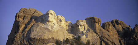 Panoramic sunrise view on Presidents George Washington, Thomas Jefferson, Teddy Roosevelt and Abraham Lincoln at Mount Rushmore National Memorial, South Dakota