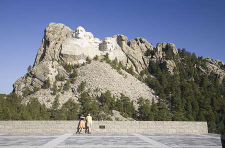 A man and woman at the Grand Terrace view of Mount Rushmore National Memorial, South Dakota
