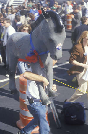 democratic donkey: Clinton supporter carries Democratic Donkey through the crowd at a Little Rock campaign rally in 1992 on final day of campaigning in Little Rock, Arkansas
