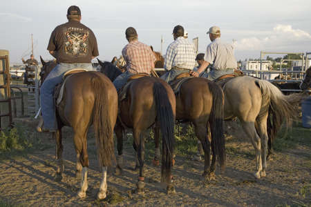 Four cowboys at PRCA Rodeo at Lower Brule, Lyman County, Lower Brule Sioux Tribal Reservation, South Dakota, 58 miles Southeast of Pierre near Missouri River, August 10, 2007