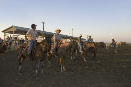 sioux: Cowboys at sunset at PRCA Rodeo at Lower Brule, Lyman County, Lower Brule Sioux Tribal Reservation, South Dakota, 58 miles Southeast of Pierre near Missouri River, August 10, 2007 Editorial