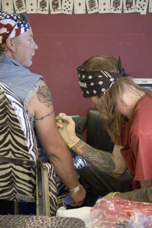 Man getting tattoo at the 67th Annual Sturgis Motorcycle Rally, Sturgis, South Dakota, August 6-12, 2007