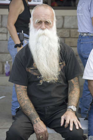 nonconformity: ZZ Top-looking man with tattoos posing at the 67th Annual Sturgis Motorcycle Rally, Sturgis, South Dakota, August 6-12, 2007