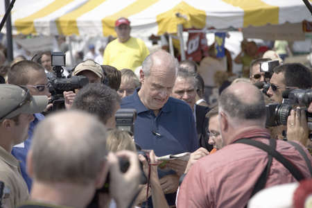 campaigning: Former U.S. Senator and actor of Law & Order, Fred Thompson signing autograph at Iowa State Fair while campaigning for U.S. President, August 17, 2007, Des Moines, Iowa