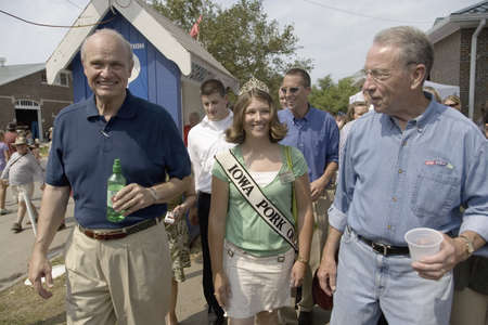 Former U.S. Senator and actor of Law & Order, Fred Thompson walking with Miss Pork and U.S. Senator from Iowa, Republican Chuck Grassley at Iowa State Fair, August 17, 2007, Des Moines, Iowa