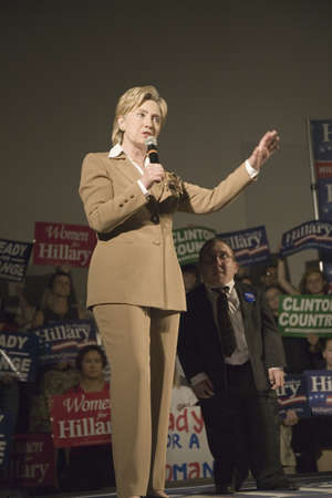 campaigning: U.S. Senator, Former First Lady and Presidential Candidate, Hillary Clinton standing tall next to a midget at rally, following Iowa Democratic Presidential Debate, Drake University, Des Moines, Iowa, August 19, 2007