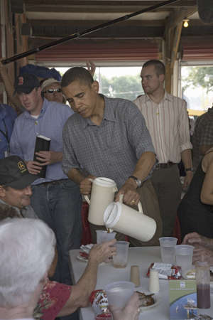 campaigning: U.S. Senator Barak Obama campaigning for President while pouring lemonade at Iowa State Fair in Des Moines Iowa, August 16, 2007