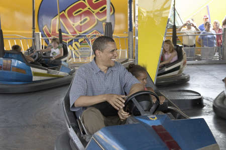 campaigning: U.S. Senator Barak Obama driving bumper car with his daughter while campaigning for President at Iowa State Fair in Des Moines Iowa, August 16, 2007