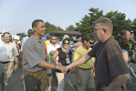campaigning: U.S. Senator Barak Obama shaking hands while campaigning for President at Iowa State Fair in Des Moines Iowa, August 16, 2007 Editorial