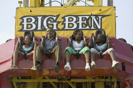 campaigning: U.S. Senator Barak Obama taking ride on Big Ben with his daughters while campaigning for President at the Iowa State Fair in Des Moines Iowa, August 16, 2007