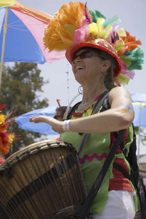 solstice: Woman drummer at annual Summer Solstice Celebration and Parade June 2007, since 1974, Santa Barbara, California
