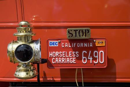 to paula: Close-up of antique red car at car rally of horseless carriages in Santa Paula, CA