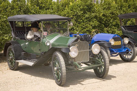 to paula: Couple dressed in old-fashioned clothing, in their antique car at rally of horseless carriages, Santa Paula CA