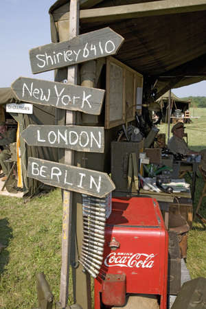 totals: World War II replica signs to New York, London, Berlin and Shirley with mileage totals in front of tents at Mid-Atlantic Air Museum World War II Weekend and Reenactment in Reading, PA held June 18, 2008 Editorial