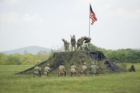 A World War II reenactment of US Marines raising the American flag on Iwo Jima on February 23, 1945 at Mid-Atlantic Air Museum World War II Weekend and Reenactment in Reading, PA held June 18, 2008 Editorial