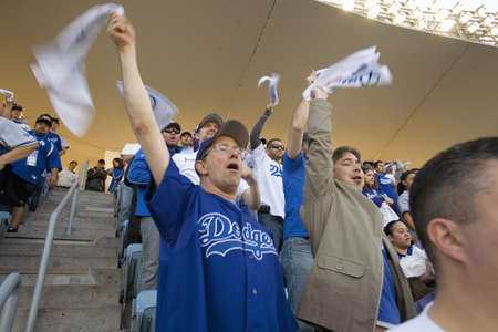 Dodger fans cheering during National League Championship Series (NLCS), Dodger Stadium, Los Angeles, CA on October 12, 2008 Stock Photo - 20803544