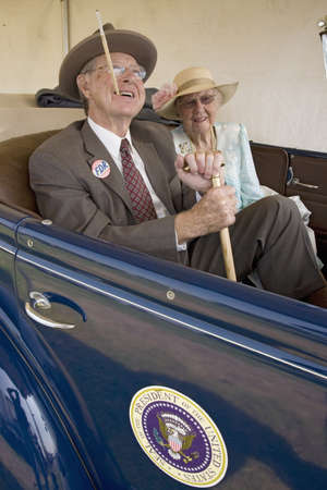 roosevelt: Actors portraying President Franklin D. Roosevelt (FDR) in Presidential limo with his wife Eleanor Roosevelt at Mid-Atlantic Air Museum World War II Weekend and Reenactment in Reading, PA held June 18, 2008 Editorial