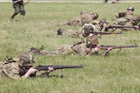 world war ii: World War II reenactment of a battle between American infantryman and German soldiers at Mid-Atlantic Air Museum World War II Weekend and Reenactment in Reading, PA held June 18, 2008