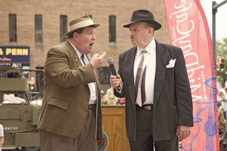 abbott: 1940s World War II home front comedian actors of Bud Abbott and Lou Costello (played by Bill Riley and Joe Ziegler) telling jokes at Mid-Atlantic Air Museum World War II Weekend and Reenactment in Reading, PA held June 18, 2009