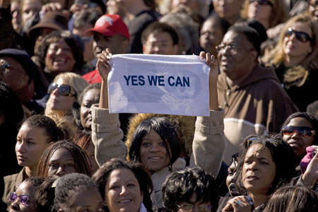 obama: African American holding Yes We Can sign at early vote for change Presidential rally for US Senator Barack Obama, October 29, 2008 at Halifax Mall, Government Complex in Raleigh, NC