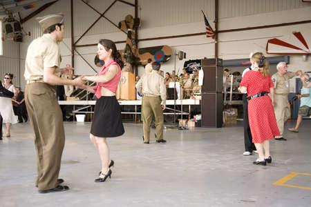 World War II actors dance in airport hanger at Mid-Atlantic Air Museum World War II Weekend and Reenactment in Reading, PA held June 18, 2009 Redakční