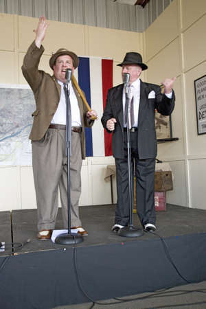 abbott: 1940s World War II home front comedian actors Bud Abbott and Lou Costello (played by Bill Riley and Joe Ziegler) telling jokes at Mid-Atlantic Air Museum World War II Weekend and Reenactment in Reading, PA held June 18, 2008 Editorial