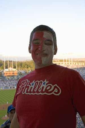 Philadelphia Phillies fan in red and white face at National League Championship Series (NLCS), Dodger Stadium, Los Angeles, CA on October 12, 2008 Stock Photo - 20803609