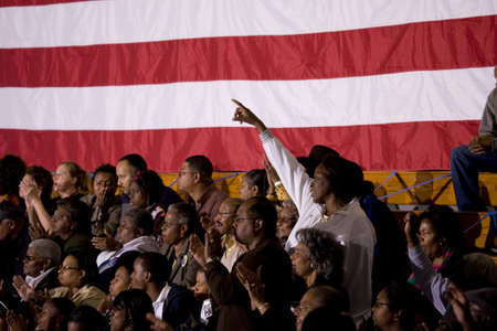 obama: African American woman standing in front of American Flag at Barack Obama Presidential Rally, October 29, 2008 in Rocky Mount High School, North Carolina Editorial