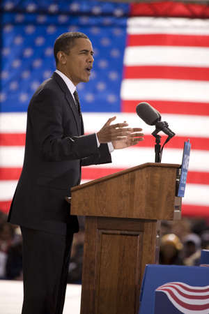 obama: Presidential Candidate Barack Obama framed against American Flag at early vote for change Presidential rally, October 29, 2008 at Halifax Mall, Government Complex in Raleigh, NC