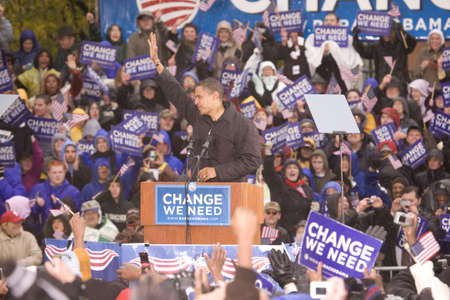 electoral: US Senator Barack Obama speaking at podium in pouring rain at Presidential Rally on October 28, 2008, at Widener University in Chester, PA Editorial