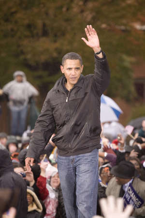 obama: US Senator Barack Obama speaking at podium in pouring rain at Presidential Rally on October 28, 2008, at Widener University in Chester, PA Editorial