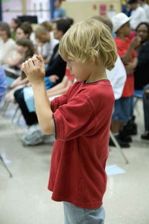blond haired: Blond haired boy in red t-shirt taking picture with digital camera at Ravensworth Elementary, Fairfax County, Springfield, Virginia