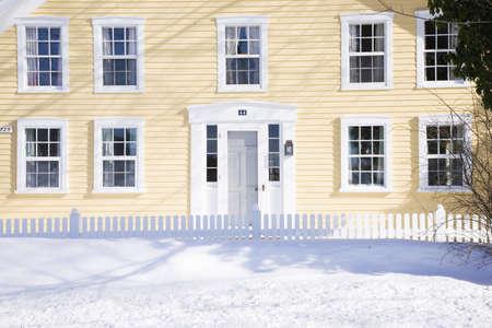 Yellow New England home in fresh snow, Ma., New England, USA